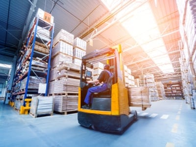 Forklift loader in storage warehouse ship yard. Distribution products. Delivery. Logistics. Transportation. Business background. Manufacturing and Warehouse Cleaning Service Cambridge