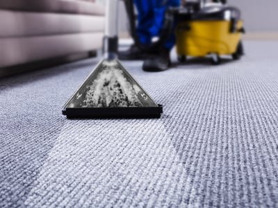 Professional Carpet Cleaning Service Company. Cleaners Using Vacuum Cleaner. Floors and carpet cleaning Cambridge office cleaning.