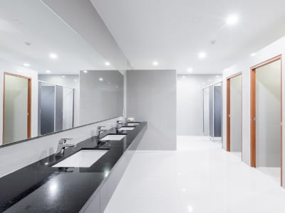 Cambridge office cleaning company. Public Interior of bathroom with sink basin faucet lined up Modern design. Janitorial services Cambridge. Cleaning services Cambridge